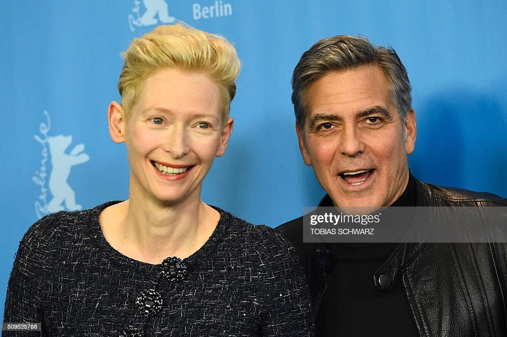 US actor George Clooney (R) and British actress Tilda Swinton pose during a photo call for the film 'Hail, Caesar!' screened as opening film of the 66th Berlinale Film Festival in Berlin on February 11, 2016. The 66th Berlin film festival starts on February 11, 2016 with a spotlight on Europe's refugee crisis. / AFP / TOBIAS SCHWARZ