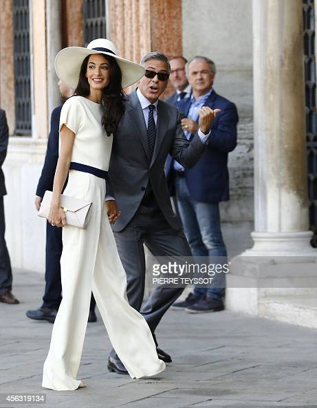 US actor George Clooney and British lawyer Amal Alamuddin arrive on September 29 2014 at the palazzo Ca Farsetti in Venice for a civil ceremony to...