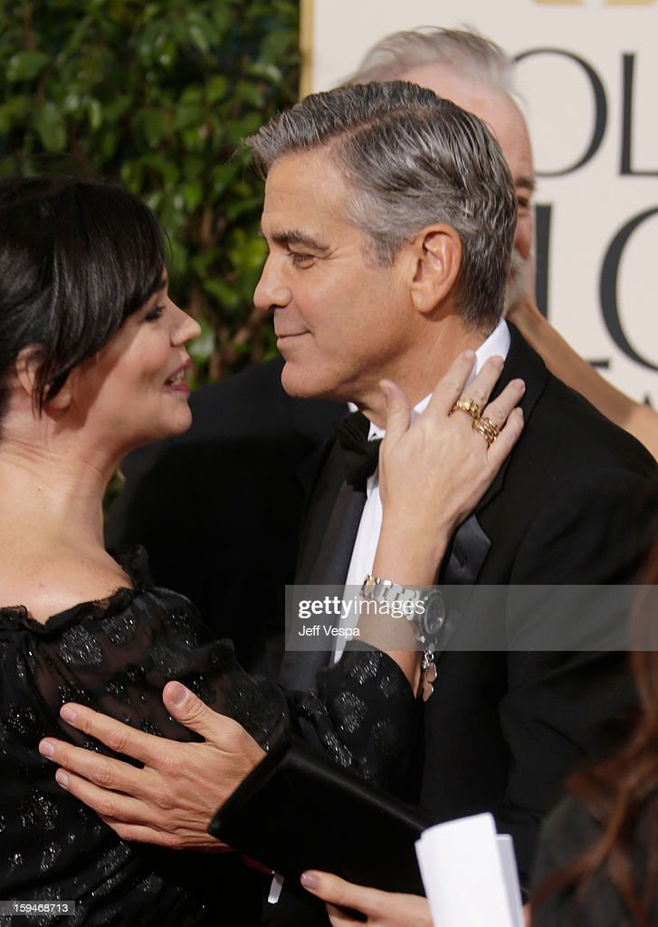 Actor <a gi-track='captionPersonalityLinkClicked' href=/galleries/search?phrase=George+Clooney&family=editorial&specificpeople=202529 ng-click='$event.stopPropagation()'>George Clooney</a> and guest arrive at the 70th Annual Golden Globe Awards held at The Beverly Hilton Hotel on January 13, 2013 in Beverly Hills, California.