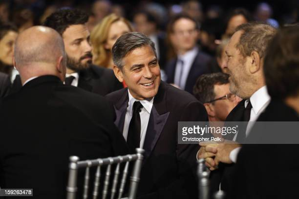 Actor George Clooney and Harvey Weinstein attend the 18th Annual Critics' Choice Movie Awards held at Barker Hangar on January 10 2013 in Santa...