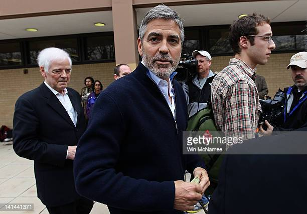 Actor George Clooney and his father Nick Clooney leave the Washington Metropolitan Police Department after being arrested outside the Embassy of...