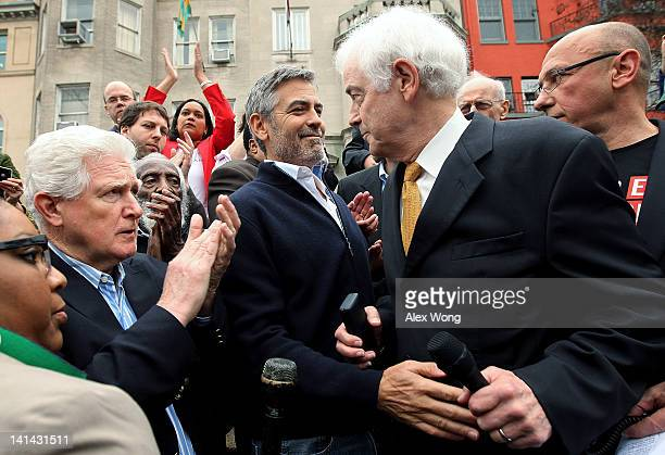 Actor George Clooney and his journalist father Nick Clooney share a moment after the older Clooney spoke as US Rep Jim Moran and President of United...