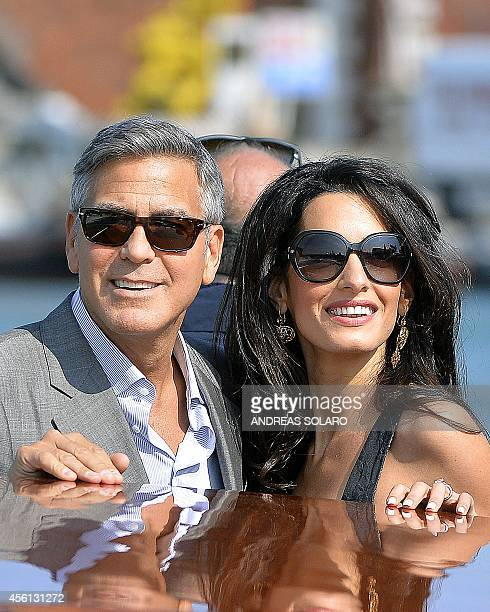 US actor George Clooney and his Lebanonborn British fiancee Amal Alamuddin take a taxiboat upon their arrival in Venice on September 26 on the eve of...