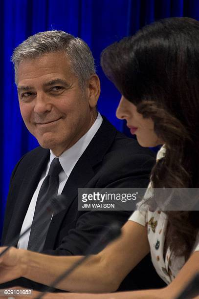 Actor George Clooney and his wife Amal Alamuddin Clooney attend the CEO Roundtable at the United Nations General Assembly in New York on September 20...