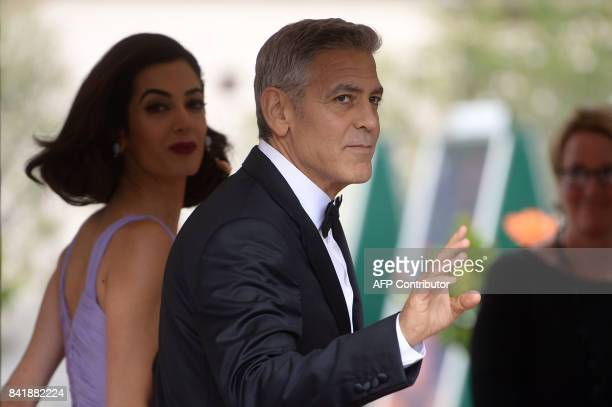 US actor George Clooney and his wife Amal arrive at the Excelsior Hotel during the 74th Venice Film Festival on September 2 2017 at Venice Lido / AFP...