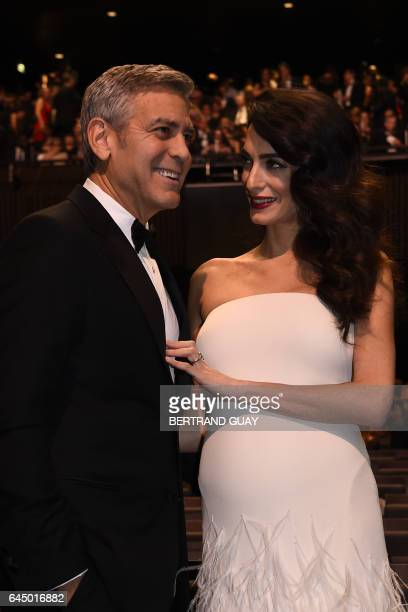 TOPSHOT US actor George Clooney and his wife BritishLebanese lawyer Amal Clooney pose as they arrive for the 42nd edition of the Cesar Ceremony at...