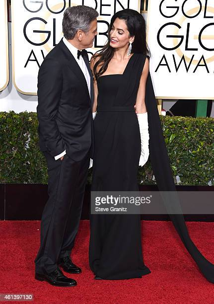 Actor George Clooney and lawyer Amal Alamuddin Clooney arrives at the 72nd Annual Golden Globe Awards at The Beverly Hilton Hotel on January 11 2015...