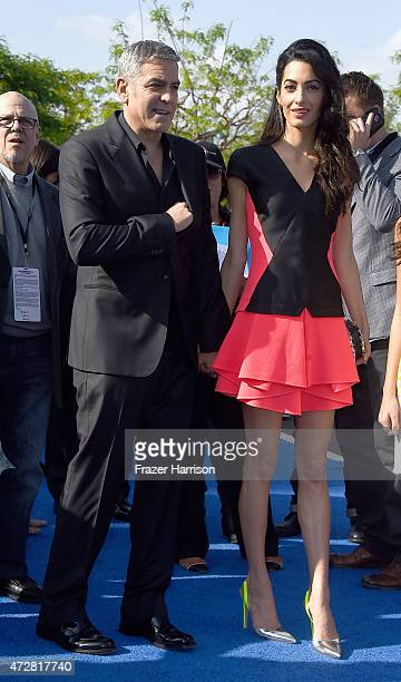 Actor George Clooney and lawyer Amal Clooney arrive the Premiere Of Disney's 'Tomorrowland' at AMC Downtown Disney 12 Theater on May 9 2015 in...