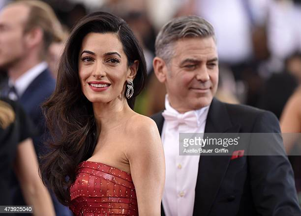 Actor George Clooney and lawyer Amal Clooney attend the 'China Through The Looking Glass' Costume Institute Benefit Gala at the Metropolitan Museum...