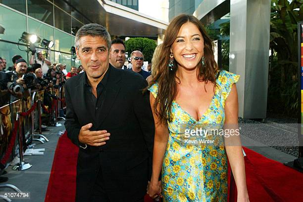 Actor George Clooney and Lisa Snowdon arrive at the premiere of Universal's 'The Bourne Supremacy' at the Arclight Cinemas on July 15 2004 in Los...