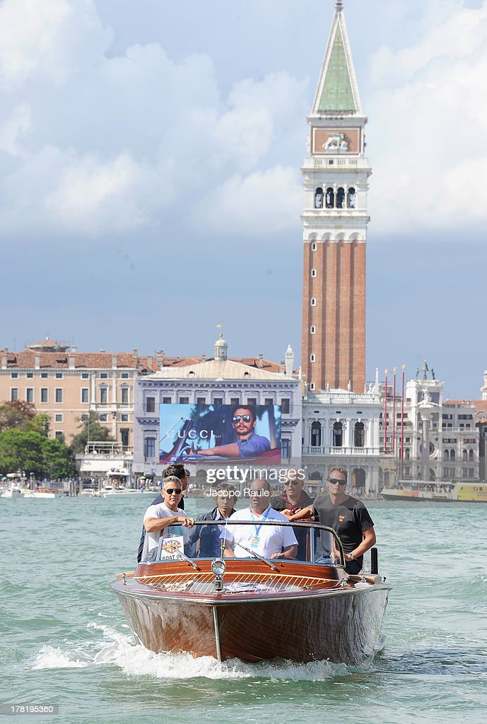 Actor George Clooney (L) and Rande Gerber (R) are seen with the Saint Mark's Campanile in the background during the 70th Venice International Film Festival on August 27, 2013 in Venice, Italy.