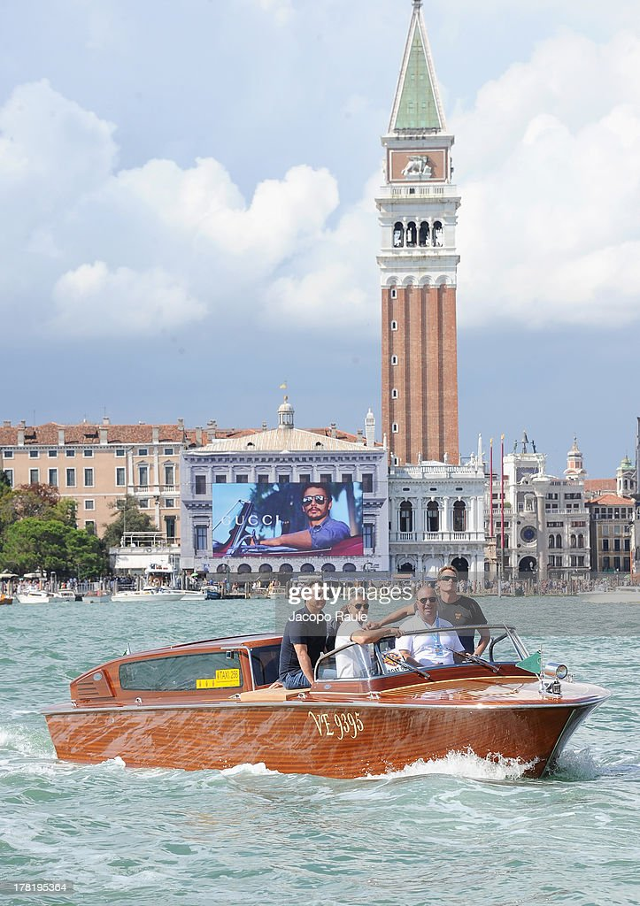 Actor George Clooney (second left) and Rande Gerber (R) are seen with the Saint Mark's Campanile in the background during the 70th Venice International Film Festival on August 27, 2013 in Venice, Italy.