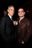 Actor George Clooney and Singer Bono of U2 attend the Fox Searchlight Pictures Belvedere Vodka And Vanity Fair Celebration of 'Martha Marcy May...