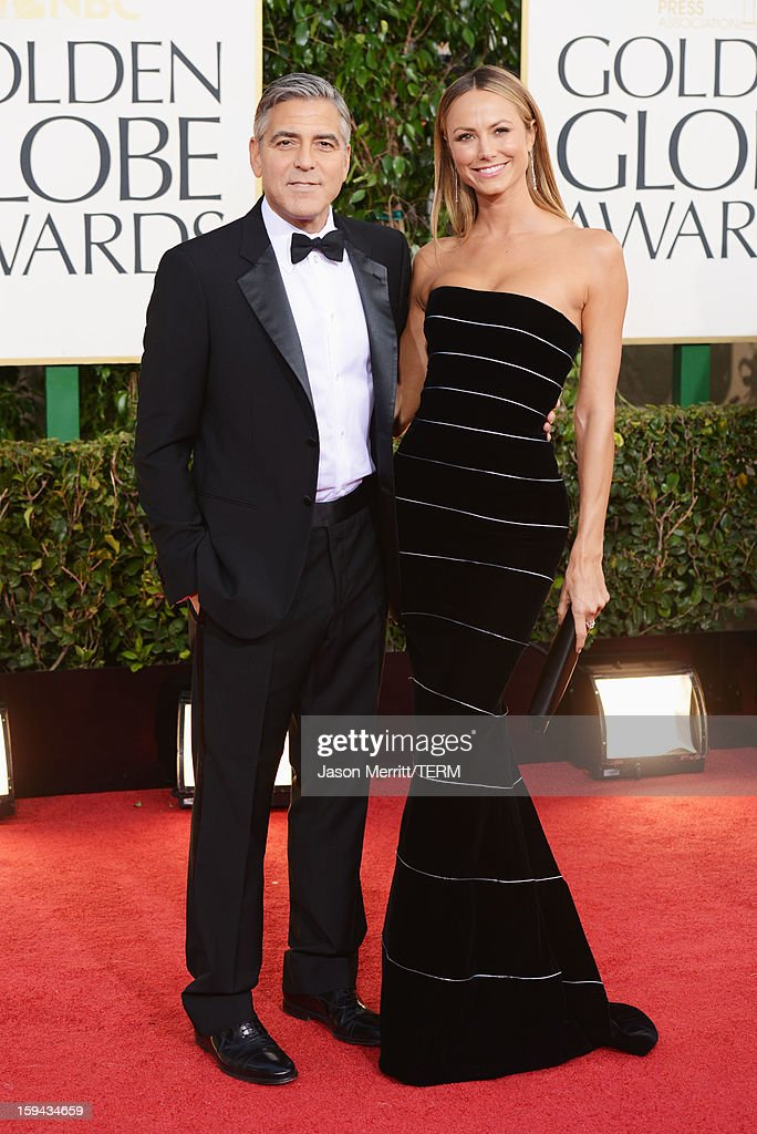 Actor George Clooney (L) and Stacy Keibler arrive at the 70th Annual Golden Globe Awards held at The Beverly Hilton Hotel on January 13, 2013 in Beverly Hills, California.