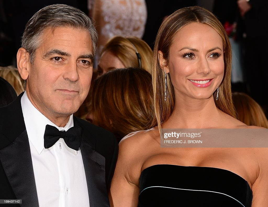 Actor George Clooney and Stacy Keibler arrive for the Golden Globe Awards in Beverly Hills on January 13, 2013. AFP PHOTO / Frederic J. BROWN