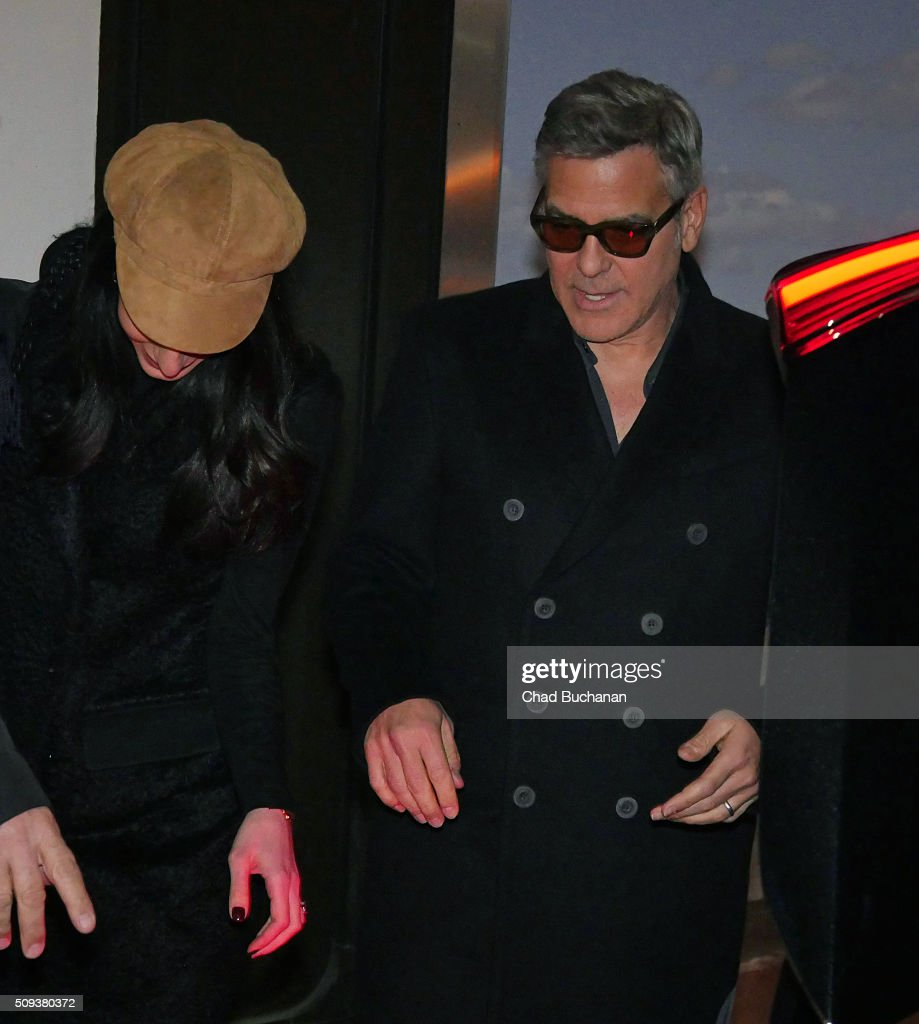 Actor <a gi-track='captionPersonalityLinkClicked' href=/galleries/search?phrase=George+Clooney&family=editorial&specificpeople=202529 ng-click='$event.stopPropagation()'>George Clooney</a> and wife Amal Clooney arrive at Tegel Airport on February 10, 2016 in Berlin, Germany.