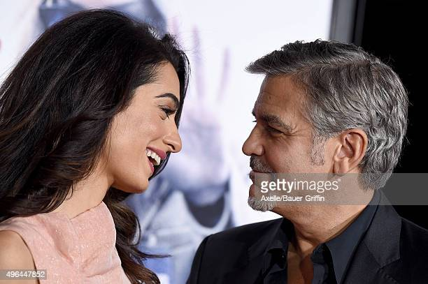 Actor George Clooney and wife Amal Clooney arrive at the premiere of Warner Bros Pictures' 'Our Brand Is Crisis' at TCL Chinese Theatre on October 26...