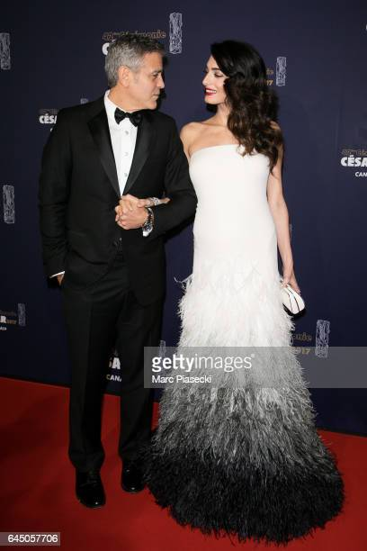 Actor George Clooney and wife Amal Clooney attend the 'CESARS Film Awards 2017' ceremony at Salle Pleyel on February 24 2017 in Paris France