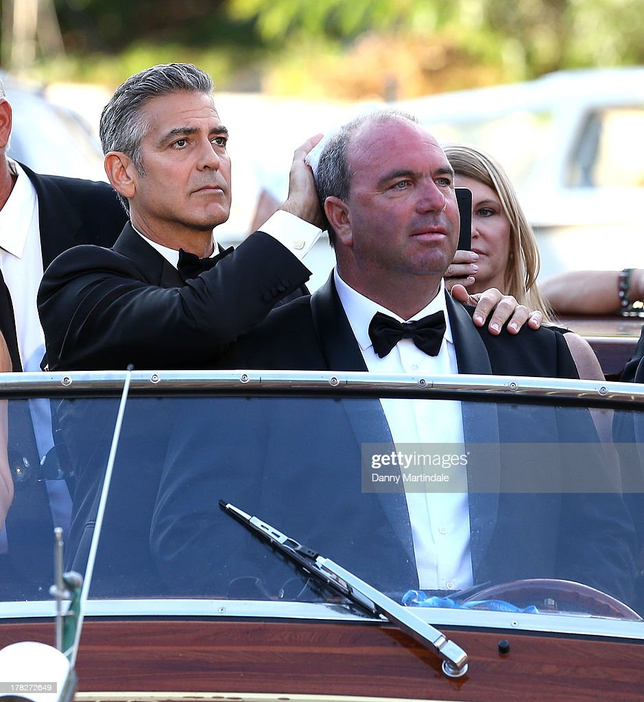 Actor George Clooney are seen joking with the boat driver as they arrive by boat for the 'Gravity' Premiere And Opening Ceremony Red Carpet on day 1 of the 70th Venice International Film Festival on August 28, 2013 in Venice, Italy.