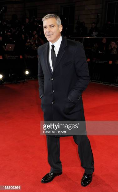 Actor George Clooney arrives at the Orange British Academy Film Awards 2012 at The Royal Opera House on February 12 2012 in London England