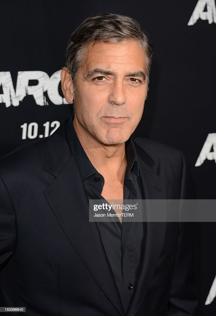 Actor <a gi-track='captionPersonalityLinkClicked' href=/galleries/search?phrase=George+Clooney&family=editorial&specificpeople=202529 ng-click='$event.stopPropagation()'>George Clooney</a> arrives at the premiere of Warner Bros. Pictures' 'Argo' at AMPAS Samuel Goldwyn Theater on October 4, 2012 in Beverly Hills, California.