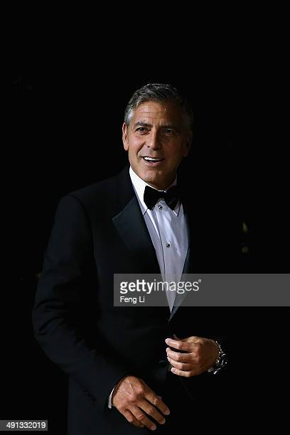 Actor George Clooney arrives for the red carpet of Omega Le Jardin Secret dinner party on May 16 2014 in Shanghai China