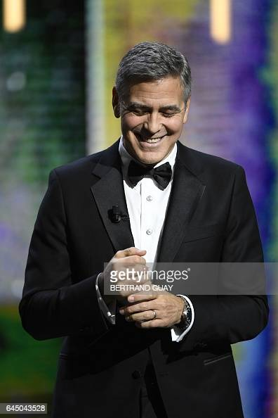 TOPSHOT US actor George Clooney arrives on stage to receive an honorary award during the 42nd edition of the Cesar Ceremony at the Salle Pleyel in...