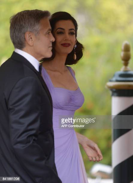 US actor George Clooney arrives with his wife Amal at the Excelsior Hotel during the 74th Venice Film Festival on September 2 2017 at Venice Lido /...