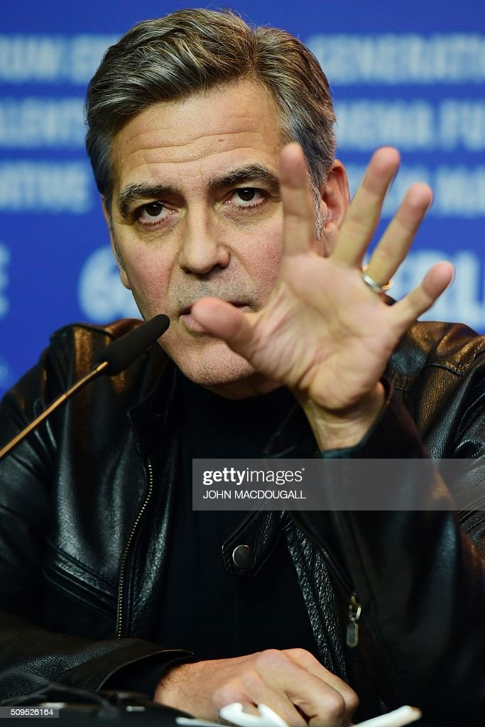 US actor George Clooney attends a press conference for the film 'Hail, Caesar!' screened as opening film of the 66th Berlinale Film Festival in Berlin on February 11, 2016. The 66th Berlin film festival starts on February 11, 2016 with a spotlight on Europe's refugee crisis. / AFP / John MACDOUGALL