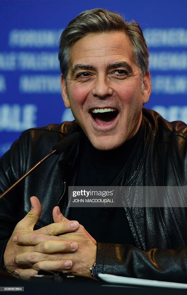 US actor George Clooney attends a press conference for the film 'Hail, Caesar!' screened as opening film of the 66th Berlinale Film Festival in Berlin on February 11, 2016. Eighteen pictures will vie for the Golden Bear top prize at the event which runs from February 11 to 21, 2016. / AFP / John MACDOUGALL
