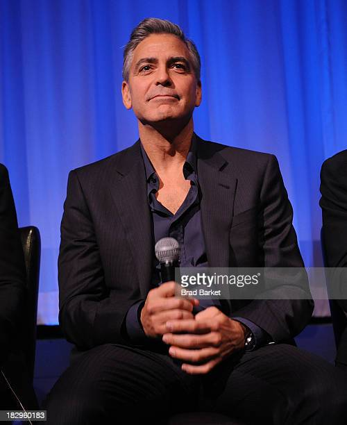 Actor George Clooney attends an official screening of 'Gravity' for Academy members hosted by The Academy of Motion Picture Arts and Sciences on...