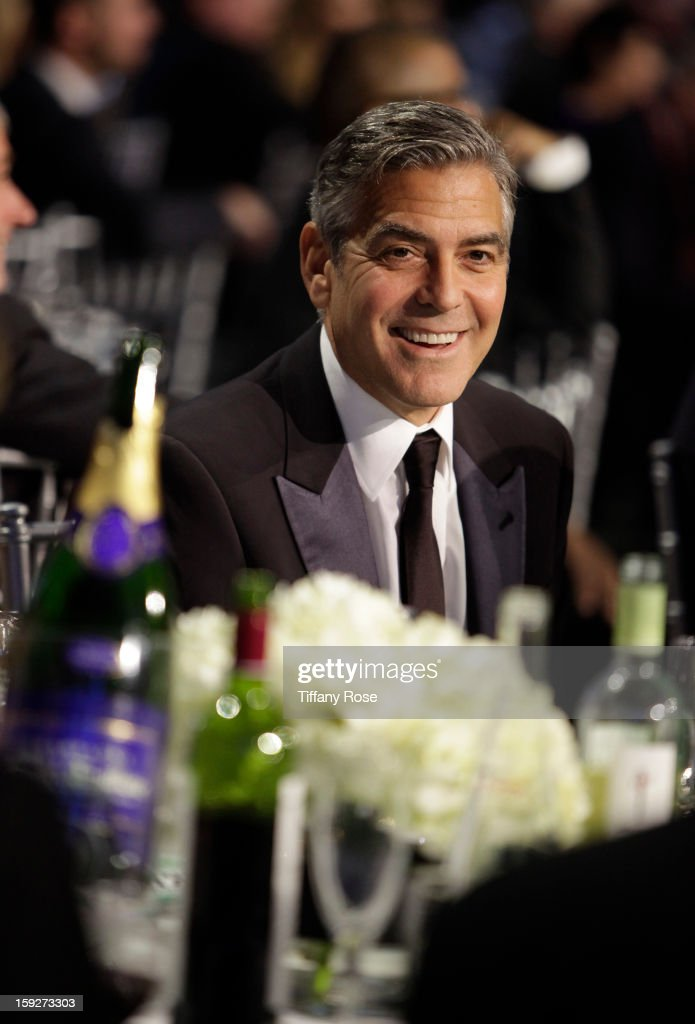 Actor <a gi-track='captionPersonalityLinkClicked' href=/galleries/search?phrase=George+Clooney&family=editorial&specificpeople=202529 ng-click='$event.stopPropagation()'>George Clooney</a> attends the Critics' Choice Movie Awards 2013 with Champagne Nicolas Feuillatte at Barkar Hangar on January 10, 2013 in Santa Monica, California.