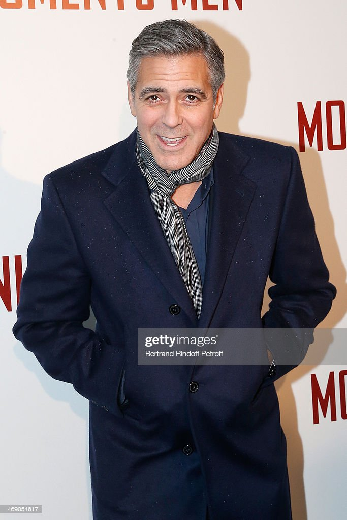 Actor <a gi-track='captionPersonalityLinkClicked' href=/galleries/search?phrase=George+Clooney&family=editorial&specificpeople=202529 ng-click='$event.stopPropagation()'>George Clooney</a> attends the 'Monuments Men' : Premiere at Cinema UGC Normandie on February 12, 2014 in Paris, France.