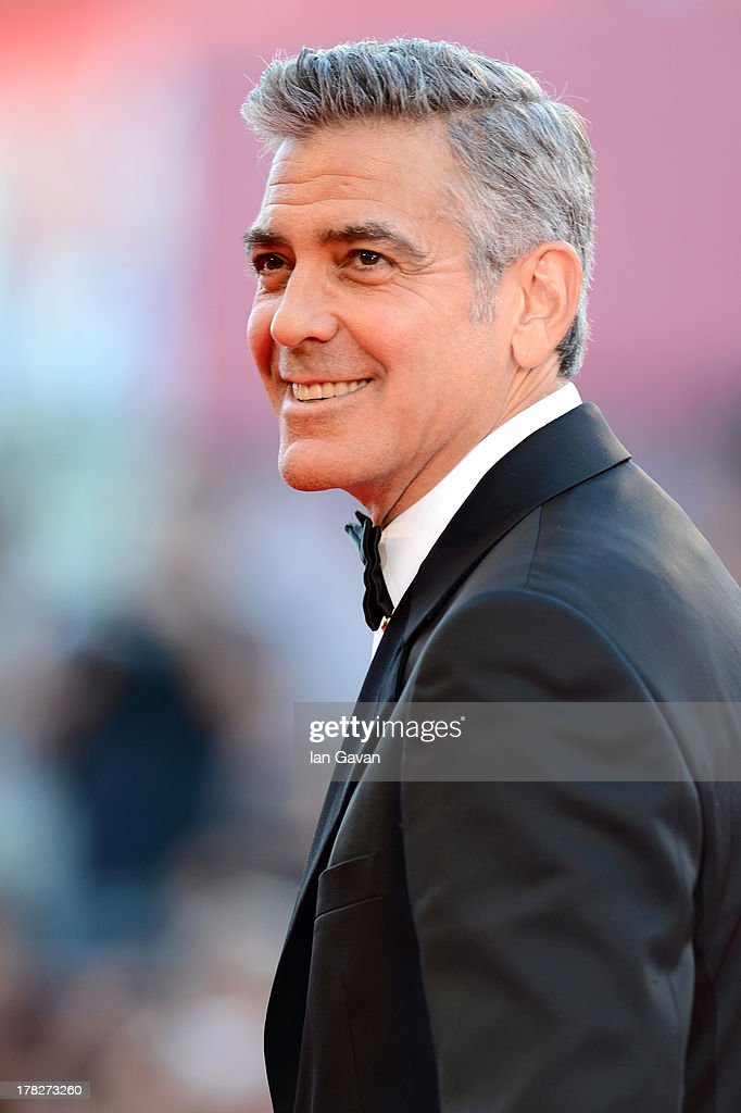 Actor <a gi-track='captionPersonalityLinkClicked' href=/galleries/search?phrase=George+Clooney&family=editorial&specificpeople=202529 ng-click='$event.stopPropagation()'>George Clooney</a> attends the Opening Ceremony And 'Gravity' Premiere during the 70th Venice International Film Festival at the Palazzo del Cinema on August 28, 2013 in Venice, Italy.
