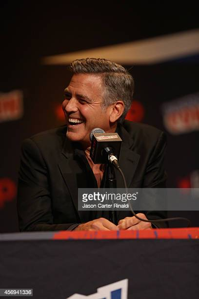 Actor George Clooney attends Walt Disney Studios' 2014 New York Comic Con presentation of 'Tomorrowland' at the Javits Convention Center on Thursday...