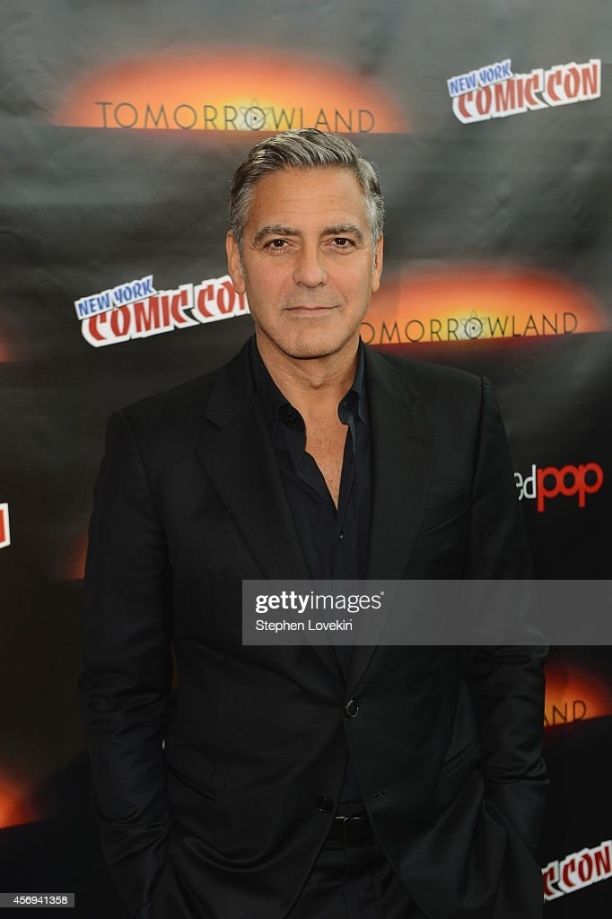 Actor <a gi-track='captionPersonalityLinkClicked' href=/galleries/search?phrase=George+Clooney&family=editorial&specificpeople=202529 ng-click='$event.stopPropagation()'>George Clooney</a> attends Walt Disney Studios' 2014 New York Comic Con presentations of 'Big Hero 6' and 'Tomorrowland' at the Javits Convention Center on Thursday October 9, 2014 in New York City.