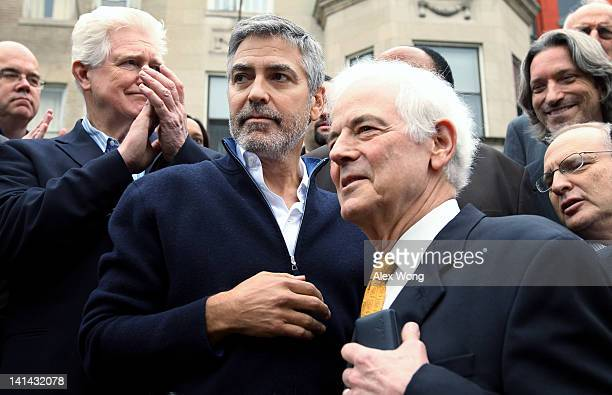 Actor George Clooney his journalist father Nick Clooney US Rep Jim Moran and other activists participate during a protest outside the Sudanese...