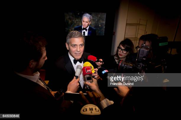 Actor George Clooney is interviewed by members of the press during the Cesar Film Awards 2017 at Salle Pleyel on February 24 2017 in Paris France