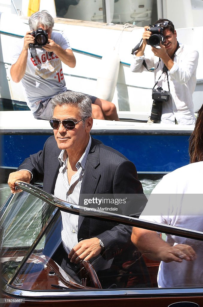 Actor George Clooney is seen being presude by the paparazzi as he arrives on a boat on day 1 of the 70th Venice International Film Festival on August 28, 2013 in Venice, Italy.