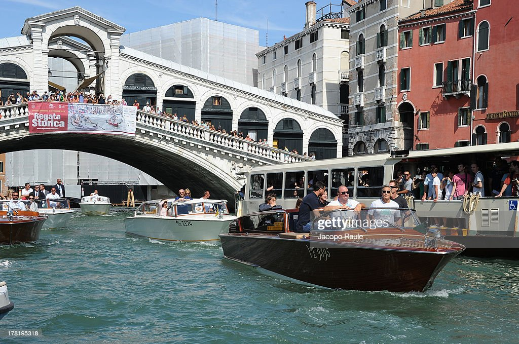 Actor <a gi-track='captionPersonalityLinkClicked' href=/galleries/search?phrase=George+Clooney&family=editorial&specificpeople=202529 ng-click='$event.stopPropagation()'>George Clooney</a> (second right) is seen with the Rialto Bridge in the background during the 70th Venice International Film Festival on August 27, 2013 in Venice, Italy.
