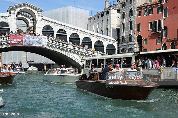 Actor George Clooney is seen with the Rialto Bridge in the background during the 70th Venice International Film Festival on August 27 2013 in Venice...