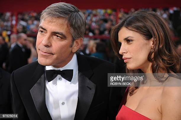 Actor George Clooney listens to a reporter's question as he arrives with model Elisabetta Canalis at the 82nd Academy Awards at the Kodak Theater in...