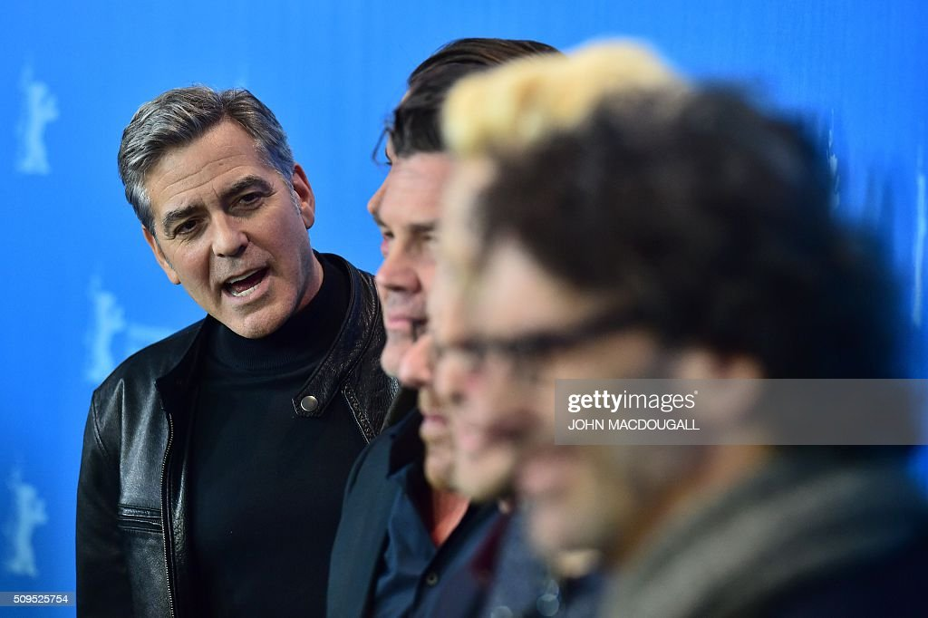 US actor George Clooney (L) poses along with other actors during a photo call for the film 'Hail, Caesar!' screened as opening film of the 66th Berlinale Film Festival in Berlin on February 11, 2016. The 66th Berlin film festival starts on February 11, 2016 with a spotlight on Europe's refugee crisis. / AFP / John MACDOUGALL