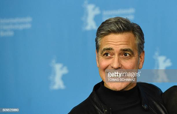 US actor George Clooney poses during a photo call for the film 'Hail Caesar' screened as opening film of the 66th Berlinale Film Festival in Berlin...