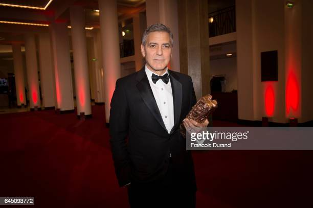 Actor George Clooney poses with the Cesar honorary award during the Cesar Film Awards 2017 at Salle Pleyel on February 24 2017 in Paris France