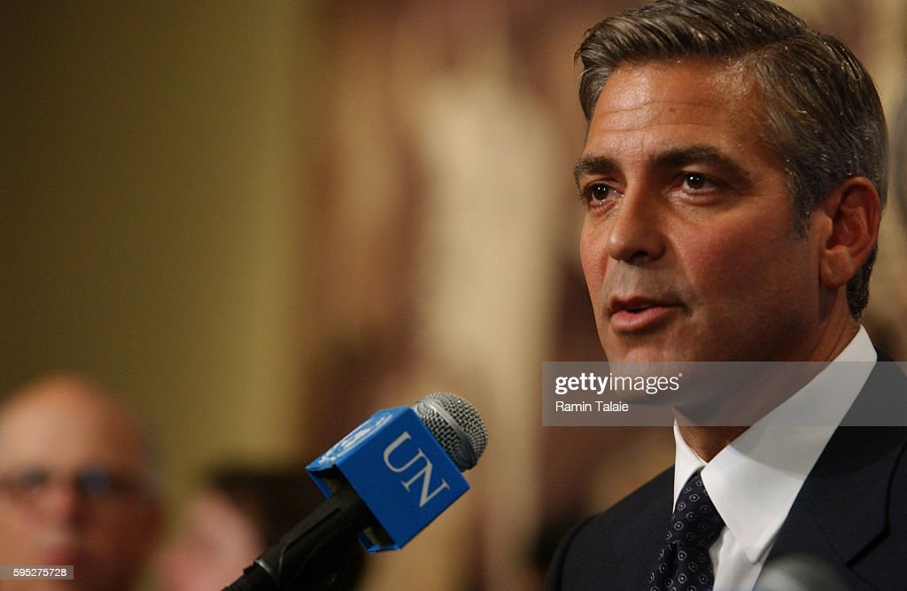 Actor George Clooney responds to questions during a news conference after addressing members of the Security Council on the human rights issues in...