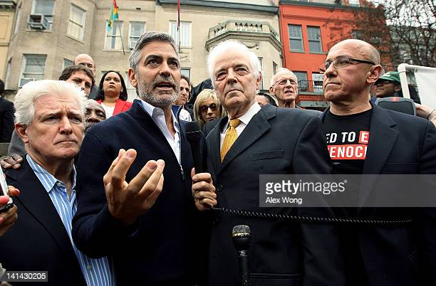 Actor George Clooney speaks as his journalist father Nick Clooney US Rep Jim Moran and President of United to End Genocide Tom Andrews listen during...