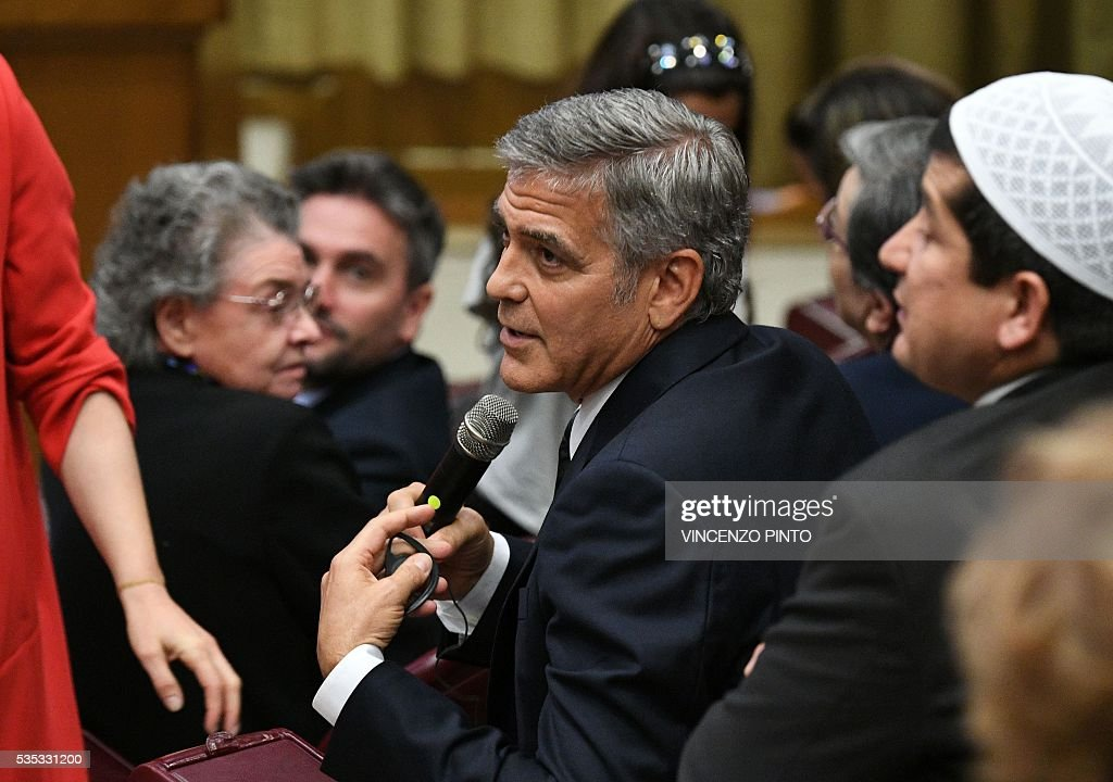 Actor George Clooney speaks before an audience of Pope Francis to the participants of the Sixth World Congress of Pontifical Foundation Scholas, on May 29, 2016 in Vatican. Scholas is an international organization of pontifical right approved and created by Pope Francis in Vatican City August 13, 2013. It combines technology with art and sport to promote social integration and culture of encounter for peace. / AFP / VINCENZO