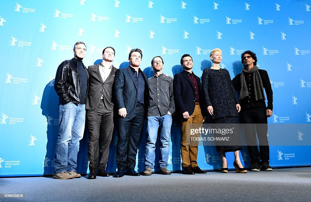 US actor George Clooney, US actor Channing Tatum, US actor Josh Brolin, US director Ethan Coen, US actor Alden Ehrenreich, British actress Tilda Swinton and US director Joel Coen pose during the photo call for the film 'Hail, Caesar!' screened as opening film of the 66th Berlinale Film Festival in Berlin on February 11, 2016. The 66th Berlin film festival starts on February 11, 2016 with a spotlight on Europe's refugee crisis. / AFP / TOBIAS SCHWARZ