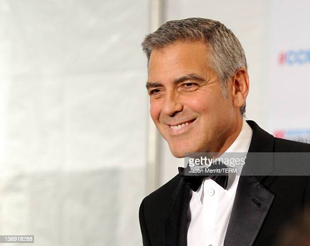 Actor George Clooney winner of the Best Actor Award for 'The Descendants' poses in the press room during the 17th Annual Critics' Choice Movie Awards...